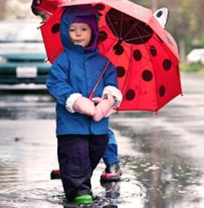 boy in red umbrella